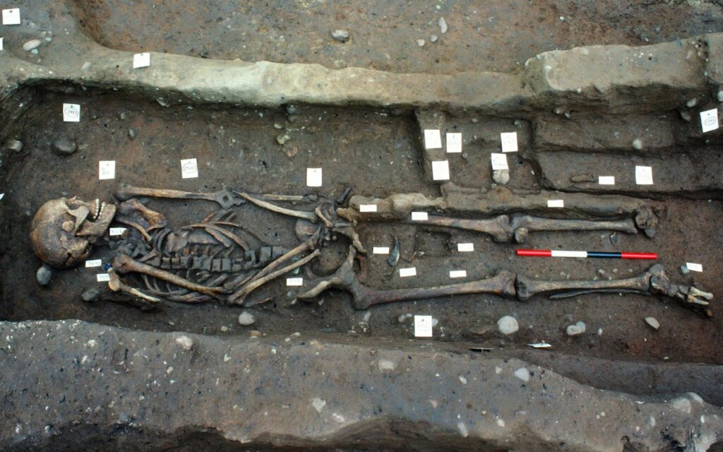 The body of a warrior holding a Viking sword and wearing a Thor pendant was also found PIC CREDIT:UNIVERSITY OF BRISTOL