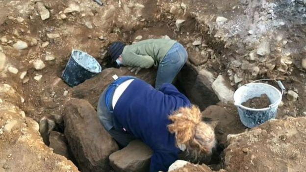 Human remains thought to be about 4,000 years old have been discovered by builders working on a hotel in rural Northumberland. The Tankerville Arms in Wooler was undergoing renovation work when they unearthed a Bronze Age stone burial chamber - or cist