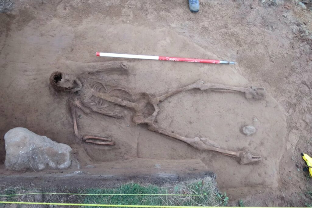 Archaeologists think the remains may be of a seaman who drowned and floated at sea before being washed up on the islet.