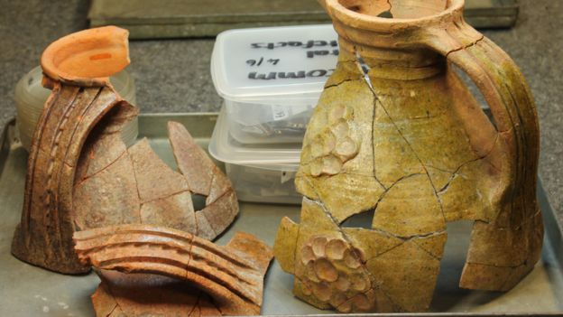 Medieval jugs found during the dig have been carefully pieced together