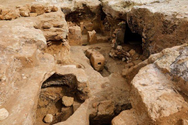 A picture taken on March 27, 2019 shows weight stones that were part of an ancient olive press at the site of the remains of a Jewish village from the Hasmonean period (approximately 2000-years-old), which are currently being uncovered by the Israel Antiquities Authority (IAA)