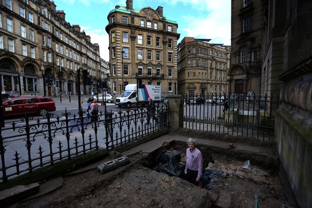 Simon Brooks showing the section of Hadrian's Wall that's been found on Westgate Road outside the Mining Institute (Image: Newcastle Chronicle)