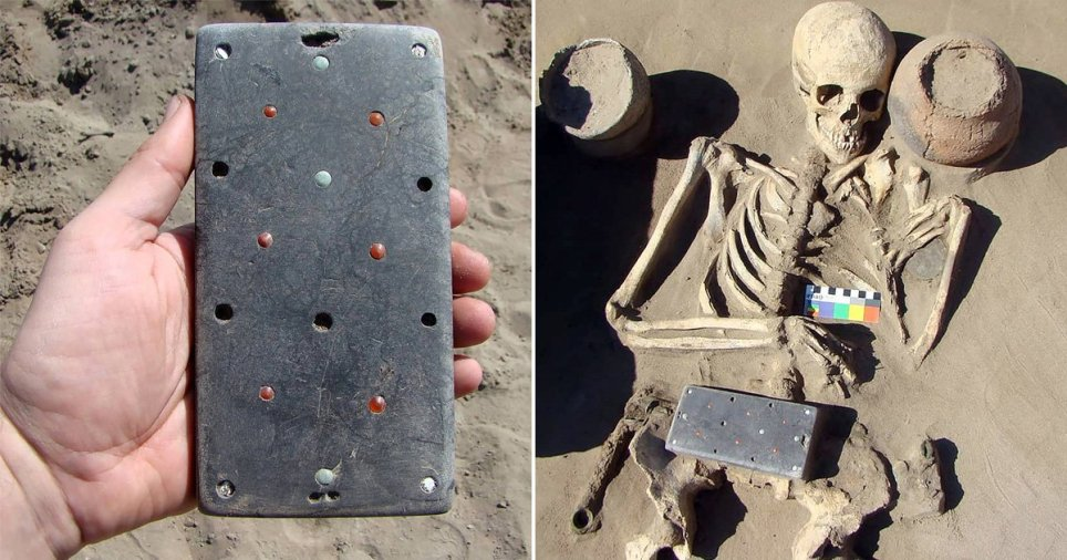 Archaeologists find ancient skeleton buried with '2,100 year old iPhone'